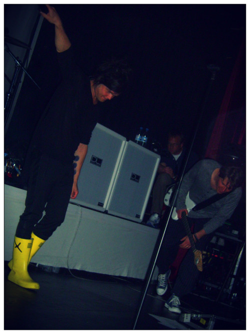 what is that new tattoo I spy? Also, why are those little yellow rain boots so damn cute?