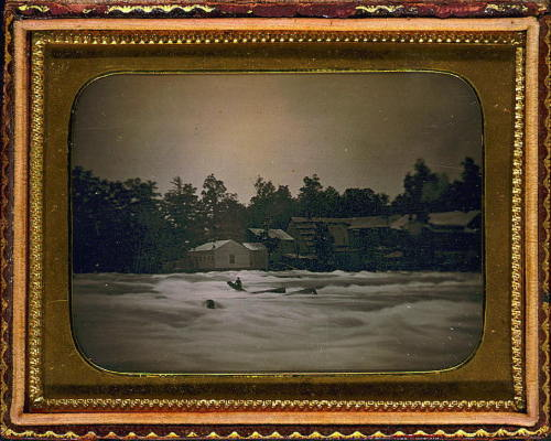 ca. 1853, [daguerreotype portrait of Joseph Avery stranded on rocks in the Niagara River], Platt D. Babbitt  Three men boating in the Niagara River were overwhelmed by the river's strong current, lost control of their boat, and crashed into a rock. The current carried two men immediately over the Falls to their deaths. The daguerreotype shows the third man, stranded on a log which had jammed between two rocks. He weathered the current for eighteen hours before succumbing to the river. The image is an early example of a news photograph.  via the Library of Congress, Daguerreotype Collection