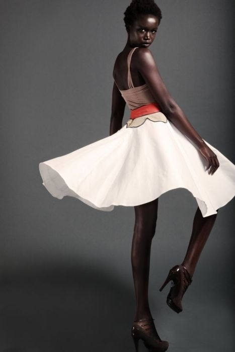 blackandkillingit:   lovelyandbrown:   twirl.   Black Girls Killing It Shop BGKI NOW