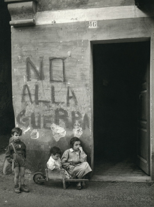 """No alla guerra"" (""No to war"") written on the wall of an Italian village which saw fighting during WWII.  Italy - 1950. (Photo by Werner Bischof)"