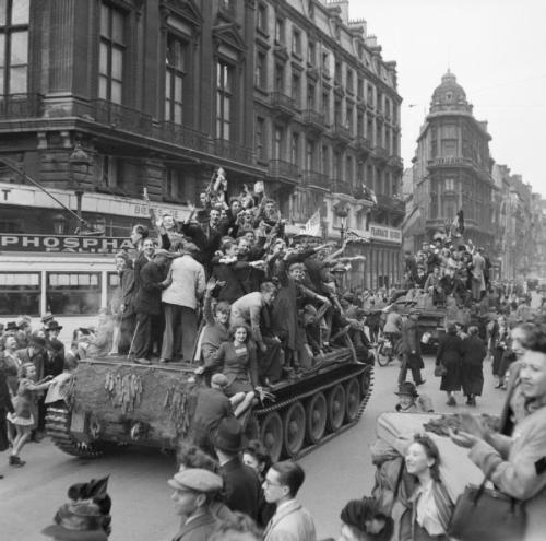 itsjohnsen:   Cheering civilians ride on Cromwell tanks as British troops enter Brussels. September, 1944. IWM