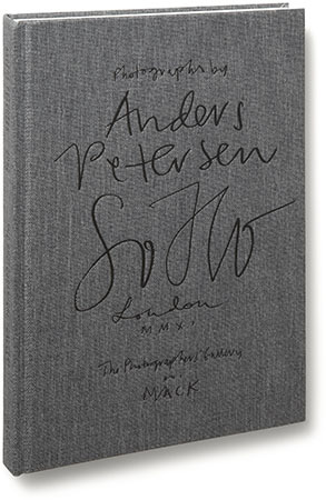 Anders Petersen SOHO Co-published with The Photographers' GalleryDesigned and edited by Greger Ulf Nilson 124 pages17.4 cm x 26.4 cmCloth cover with embossing on front and spine with a tipped-in image on back Publication date: May 2012 ISBN 978-1-907946-22-6 Publisher's Description:   The Soho described by Robert Louis Stevenson in The Strange Case of Dr. Jekyll and Mr Hyde as 'a district of some city in a nightmare' is dramatically different to the one discovered in 2011 by renowned Swedish photographer Anders Petersen. As part of a series of off-site artist commissions supported by Bloomberg, Petersen was invited by The Photographers' Gallery to undertake a four-week residency in the bubbling creative underbelly of London. Turning his direct and unflinching gaze to the streets of Soho, Petersen produced a series which is both penetrating and sensitive to his subjects. His intimate, diaristic style of coarse black and white photography captures the essence of today's Soho while drawing you back into the depths of its history. For a month Petersen immersed himself in the life of the famous London district, documenting the streets, pubs, cafes and private homes of the residents. This latest installment of his series City Diaries is a testament to the dynamism and diversity of the area and the people who frequent and live in it. (via MACK - Anders Petersen - SOHO)