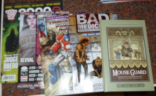 jamesmason01:  My Free Comic Book Day grabs: 2000AD (2000AD): I really enjoyed parts of this, but as you'd expect from an anthology comic, some tales seemed significantly better than others. I'd been planning on trying 2000AD for a while, but this didn't quite push me over the line to adding it to my pull. Some of the stories were good, though: Judge Dredd: On the Job: This was alright, but I've read better Dredd (Judge Death) and better takes on futuristic journalism (Transmet) so all in all it didn't blow me away The Grievous Journey of Ichabod Azrael (and the Dead Left in his Wake): The first couple of pages were alright; good-looking, standard cowboy fare. It was slowly growing on me until the last couple of pages, when a twist occurs in the story, and the page design really steps up a notch; I'm definitely curious as to how the rest of the series will be. It definitely grabbed my attention. Zombo: The Day the Zombo Died: Part One: This was a reasonably creepy concept for a villain, but the OBMOZ character didn't grip me at all. I've never read any Zombo material before, which might have been part of the problem. Ro-Busters: Pretty standard Moore sci-fi fare. It was alright, and definitely a pretty good example of the genre, but I didn't particularly enjoy it that much. Future Shocks: The Green Pedestrian Palm: By far the best part of the issue, this was a great short both art- and story-wise.  If you are unsure about putting it on your pulllist you could always check out a few digital progs first. Or have a read of the Forbidden Planet blog Prog Pledge, which gives a new reader's perspective on jumping into 2000AD. Or track down any graphic novel collections that take your fancy. Basically, lots of different ways to ease into the galaxy's greatest comic.