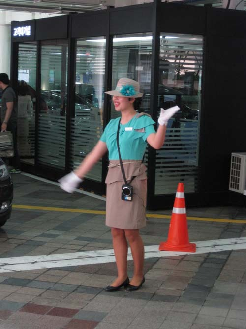 Lotte Department Store parking attendant — they all dress like this — tho men are in pants, not skirts.