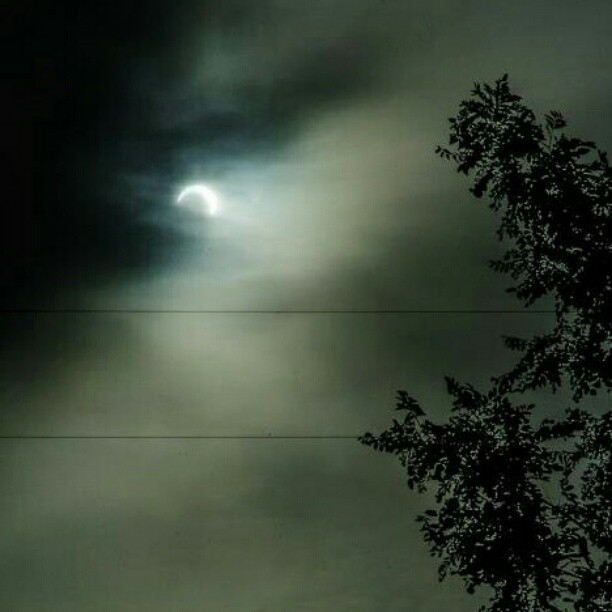 The best I could get before the clouds ate it up. #eclipse #sun #wenatchee  (Taken with instagram)