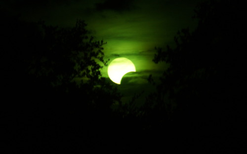 The eclipse today over San Antonio, TX. The greenish color is coming from my dad's welding mask which I placed in front of my dslr.