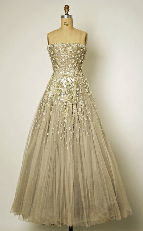 Chambord by Christian Dior 1954.  I seldom post anything clothes related… well, because fashion generally bores me. However, props. This dress fails to bore me. In fact, I find it rather beautiful. Another dress I like is Venus by Dior 1949.  Both dresses are held at the Metropolitan Museum of Art