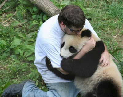 "cuteoverdose:  Reassuring an endangered species. ""it's ok, you'll get through this""more cute here  honestly that panda looks likes its omnomnoming on his arm, maybe he is going through starvation and the guy is offering himself up as food?"