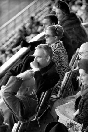 Princess Grace in leopard coat with Prince Rainier at a football match in 1962.