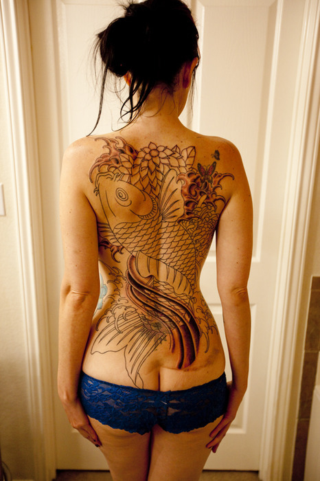 That's is a nice tattoo on her back.