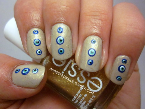 I saw some Nazar nails floating around tumblr a couple weeks back (but I don't know who to credit!), and my dad also suggested them so here we are! You can read up on the evil eye here.