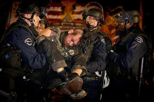 An Occupy Los Angeles supporter is arrested and carried out of the camp by Los Angeles Police officers at the L.A. City Hall, 11/30/2011. [Cryptome]