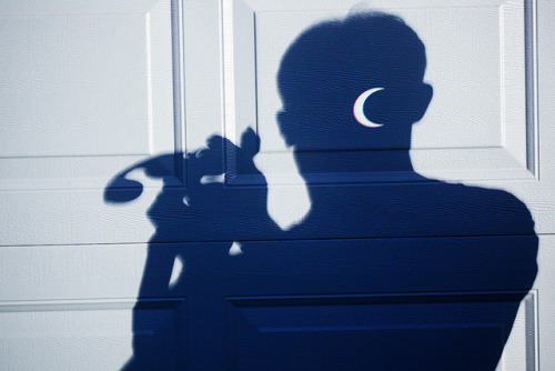Crescent head on Flickr.  The annular solar eclipse projected onto a garage door using a pair of binoculars.