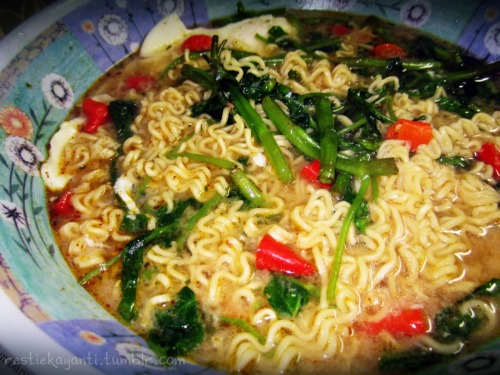 Indomie + kangkung + telur + cabe  *though someone said 'yucks!' when he saw this picture, but I'd like to say it's yummy! :D*