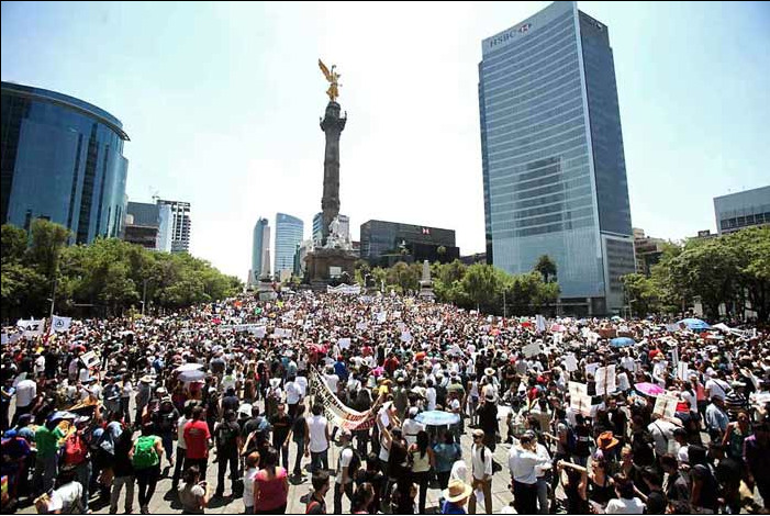 "processedspirits:  Mexican Youth March Against Old Ruling Party MEXICO CITY (AP) — Thousands (46,000 estimated)  of college-age demonstrators marched down Mexico City's main boulevard Saturday to protest a possible return of the old ruling Institutional Revolutionary Party, known as the PRI, which held Mexico's presidency without interruption from 1929 to 2000 PRI presidential candidate Enrique Pena Nieto leads in polls ahead of the July 1 election, but he was heckled by young protesters during a recent appearance at a university. Students blamed him for a violent crackdown on protesters outside Mexico City in 2006. Later, some PRI members suggested the hecklers weren't really students, further enflaming passions. In a move unusual for Mexico, the demonstrators did not carry banners for any of the other three candidates in the presidential race, instead shouting slogans against what they don't want, a return of the PRI, whose 71-year-rule was marked by repression, corruption and periodic economic crises. Playing on the PRI's name, one banner read ""I don't want a PRImitive Mexico."" Another banner read: ""We don't forgive or forget 70 years of corruption."" The New York Times published the information, read the full article here. tl:drIf relevant actions occur every 100 years in my country I want to be part of it. I don't think I can wait another 100 years to make a change. It's scary, but it feels good to know that people are waking up and shouting down the streets."