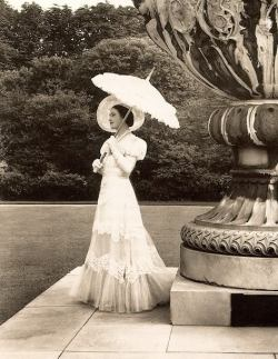 Her Late Majesty Queen Elizabeth, The Queen Mother posing near the Waterloo Monumental Vase. Buckingham Palace.