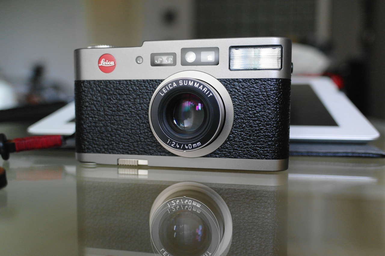 entropytango:  Leica CM, 35mm compact. Titanium, Made In Germany, Fabulous Summarit 40mm lens. Just an exquisite photography tool, and object of desire :). To hold it is to understand the Leica mystique…and absolute self-indulgence..I was lucky enough to find one, ex-showroom display model, mint and unused with all the (fancy) boxes, and a fresh 3 year warranty. Just don't ask how much…..