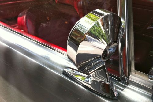 wing mirror on classic, and red leather.