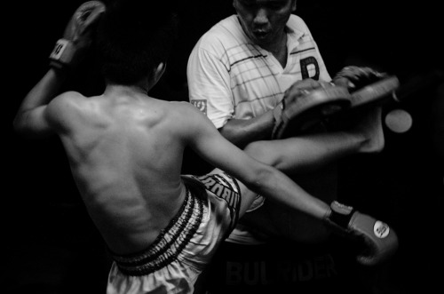 I fight, therefore I survive | Bangkok | Documentary - Young boy practices Muay Thai with coach in the slum.