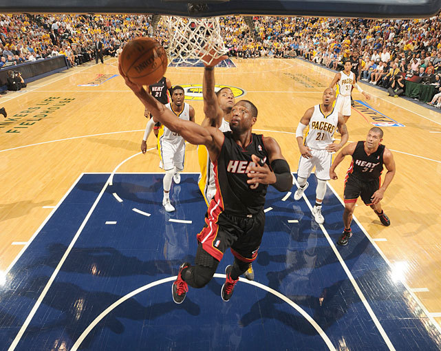 Dwyane Wade charges to the basket during Game 4 of the Eastern Conference Semifinals between the Heat and Pacers. After a poor Game 3, Wade was back on his game, scoring 30 points in Miami's 101-93 victory. The series is tied 2-2. (Ron Hoskins/NBAE via Getty Images) MANNIX: Wade-James answer call for HeatGALLERY: Rare Photos of Dwyane Wade