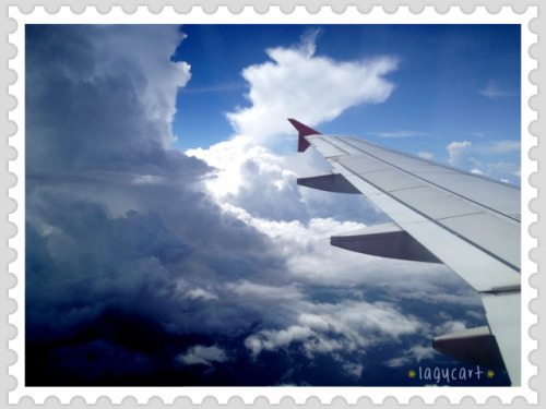 clouds in the sky. on the way to bali and took this shot from the plane window, the clouds are fluffy and pretty. =p