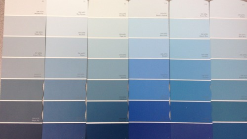 Choosing a paint color: As stressful as the GREs Maybe it's because I'm inexperienced in choosing paint colors but I broke out into cold sweats in Sherwin Williams trying to decide on the perfect shade of light blue (but not baby blue or turquoise blue or grey blue). The magic light that you hold the paint chip under to demonstrate various lighting didn't help either - it kept turning my subtle light blue into scary baby blue nursery. Cue Psycho-style WEE WEE WEE WEE!  Mountain Air was my final laundry room answer.  I wanted something definitely blue but light enough that the small space would still feel open. I also picked up a bright white glossy paint for the trim, a quality paintbrush, biodegradable paint trays, drywall spackle and a roller and $120 later I was on my way. Since this was a fairly simple remodel, the only other major item we needed was a cabinet. Home Depot had simple, contractor-grade kitchen cabinets that were small enough that we'd need two. At $97 a pop though, we would have already busted our budget. The laundry room was not worth $300+ to us, so we headed off to the Habitat for Humanity Restore.  Cue angels! A brand-new, already white, contractor-grade kitchen cabinet set that just needed a Fantastik wipe-down was staring us in the face with its $60 price tag. Minutes later, it was on its way to its new home. As the materials sat in the garage over the weekend, we strategized how to tackle our first DIY home improvement project and came up with a plan. To be continued…