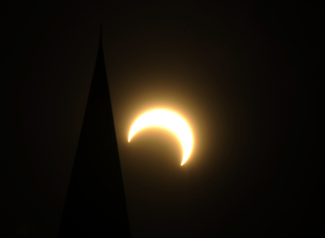 128 photos of the solar eclipse Pictured: The solar eclipse from Colorado State Capitol building in Denver, Colo, on Sunday, May 20, 2012. Hyoung Chang, The Denver Post