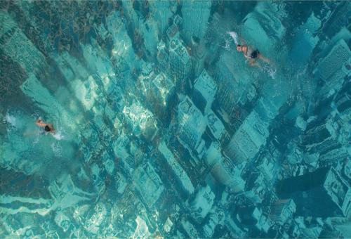 cjwho:  Swimming pool with New York skyline, Mumbai The eye-catching swimming pool in Mumbai, India, has been built to raise awareness about the threat of sea level rises as a result of global warming. It was constructed by attaching a giant aerial photograph of the New York City skyline to the floor of the pool. The idea was conceived by advertising agency Ogilvy & Mather, who were commissioned by banking giant HSBC to promote its £50million project tackling climate change. The Ogilvy team came up with an innovative way to show the adverse impact of global climate change. They glued an aerial view of a city to the base of a swimming pool. When the pool was filled with water, it gave a shocking effect akin to a city submerged in water. The visual of a sunken city shocked swimmers and onlookers, driving home the impact of global warming, and how it could destroy our world someday. http://www.ogilvy.com