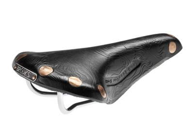 Brooks Team Pro Alpe d'Huez saddle. There is still one at the local shop here although Brooks is sold out of them. The warnings by the manufacturer to not get it wet keep me from it..  I love the design though. For some reason it reminds of Joy Divisions Unknown Pleasures LP cover of the bursts from the first known Pulsar.
