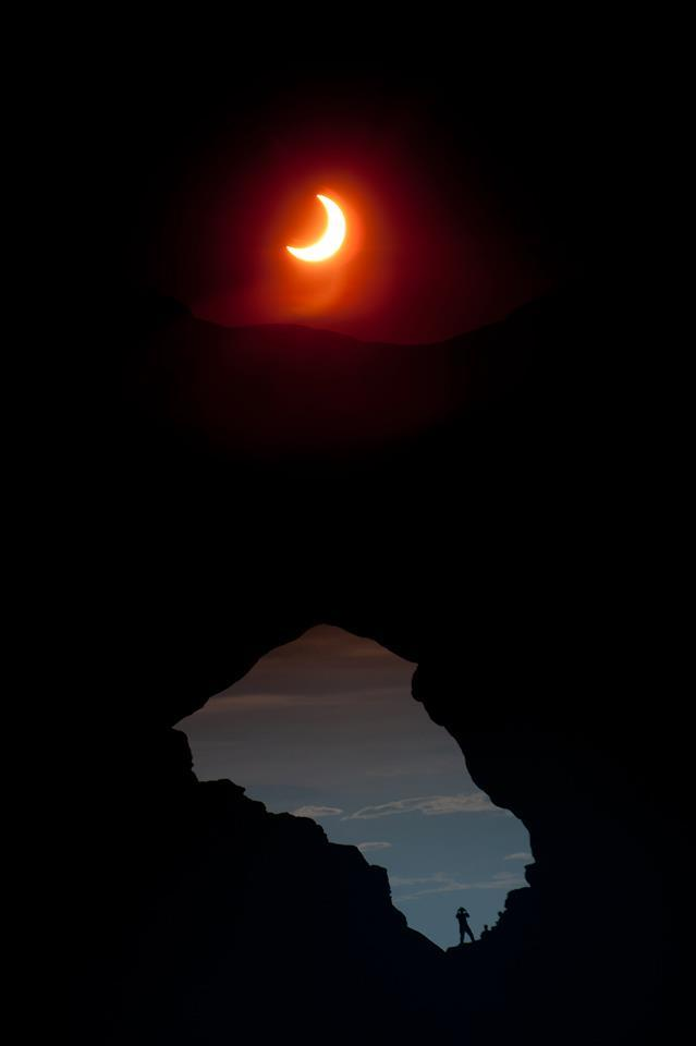 Image description: A picture of the solar eclipse that happened over the weekend taken at Arches National Park in Utah. Photo from the National Park Service.