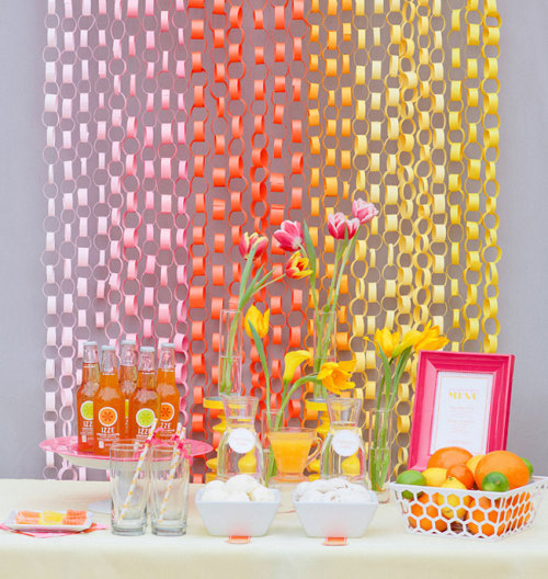 A paper chain backdrop would probably be cheaper than a ribbon backdrop! Because we all know how overpriced ribbon is!