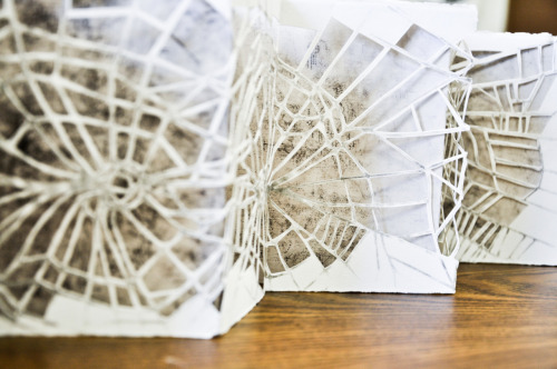 Cut paper spiderwebs. concertina bind. :]