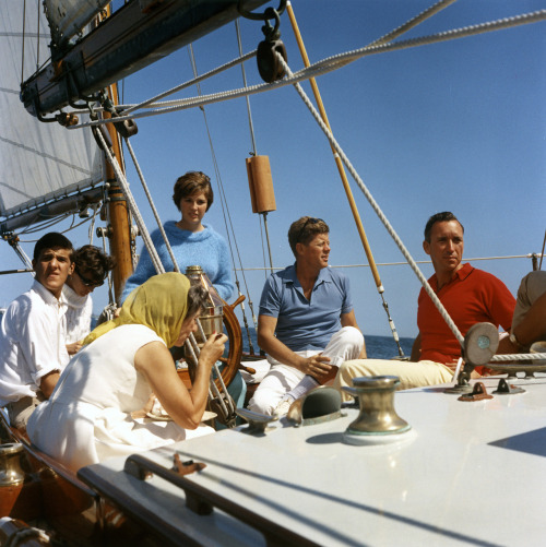 jfklibrary:  A photo of JFK sailing about the Manitou in 1962 (Robert Knudsen/JFK Library) Does anyone recognize the man in the white shirt?