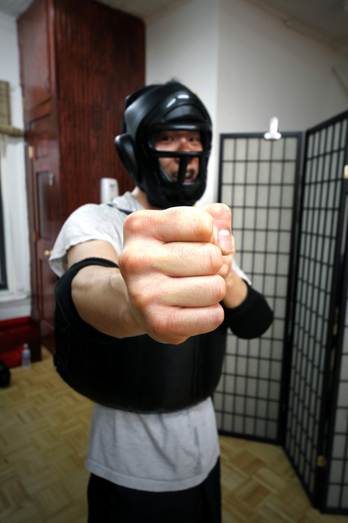 citywingtsun:  Joseph gears up for Lat Sau.  love this photo of my sidai Joseph. We have a habit of making each other bleed on each others' shirts on Saturdays….