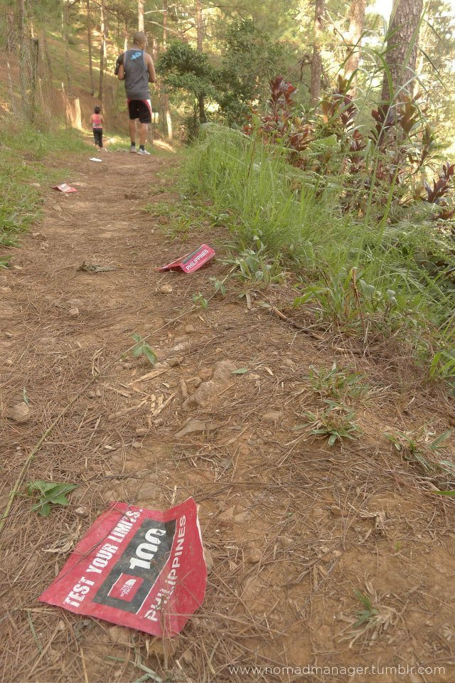 "Yellow Trail, Camp John Hay, Baguio: The North Face Litter Trail I am not a runner. 8 minutes into running and I am spent. So I'm not quite sure what I was thinking when I agreed to go on a 45-minute trail run / jog with Karlo and his fit sister Maria. Nevertheless, the mountain vista brought its allure, and while I dreaded the physical exertion involved in running, I was looking forward the panoramas I would see along Camp John Hay's Yellow Trail.    When I wasn't out of breath, I enjoyed running the trail, and being challenged to avoid ""obstacles"" such as rocks, fat tree roots and rickety bridges. However, one obstacle I couldn't help but avoid were the sports drink bottles and other litter my eyes landed on along the trail. Maria says she used to run the trail before going on a sort of hiatus in March this same year, and she was surprised to find all the litter that we did. I didn't get a picture of the other litter, but I did get this:  I later found out that R.O.X. / The Primer Group and The North Face organized the TNF 100 through this trail 2 weeks prior to our visit to Yellow Trail. Sad that they managed to organize the entire event and bring in participants from Manila, but they failed to organize a post-run ""sweeping"" crew to go through the trail for any litter, or in this case, evidence of their negligence / indifference. The moment people ""discover"" a new natural wonder, it's not long before it gets defaced (warrants a post of its own). And a lot of people are so complacent about their litter, when they could very easily just hold onto their trash until they see a trash bin. Just a candy wrapper, you say? How would you like it if repeatedly kept throwing candy wrappers in your living room just because I was too lazy to exert the painstaking effort of throwing it in the proper place? Littering is one of my pet peeves, people. And I'll be taking it upon myself to document these seemingly little crimes. I am one person, so not all violators will witness my wrath, but all violators will witness Mother Earth's. The next time you feel the urge to litter, think about the effect of cumulative litter, and remember how easy it would be to just hold on to your trash a little longer. The next time you see a lazy, selfish turd littering, by all means, give him / her a piece of your mind (or politely tell them they dropped something, and that they pick up their litter — this is obviously more ""correct"", but do whatever is more effective, really). Doing her bit of planeteering,Jen Twitter 