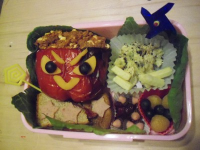 Angry Pepper bento! This is an old bento my older sister made. It's a stuffed pepper, eggs, bread, apollo sweets, then blueberrys and yellow raspberries.