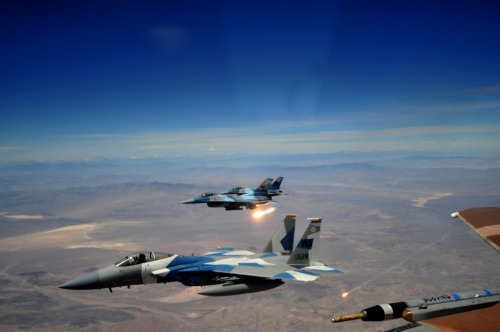 retrowar:  A U.S. Air Force F-15E and two F-16s from the 65th Aggressor Squadron fly in formation after a dogfight against members of the Air Force Weapons School over Nellis Air Force Base, Nev., May 17, 2012.  Relevant to Katie Porter's July release: DOUBLE DOWN.  More info on this erotic romance HERE.