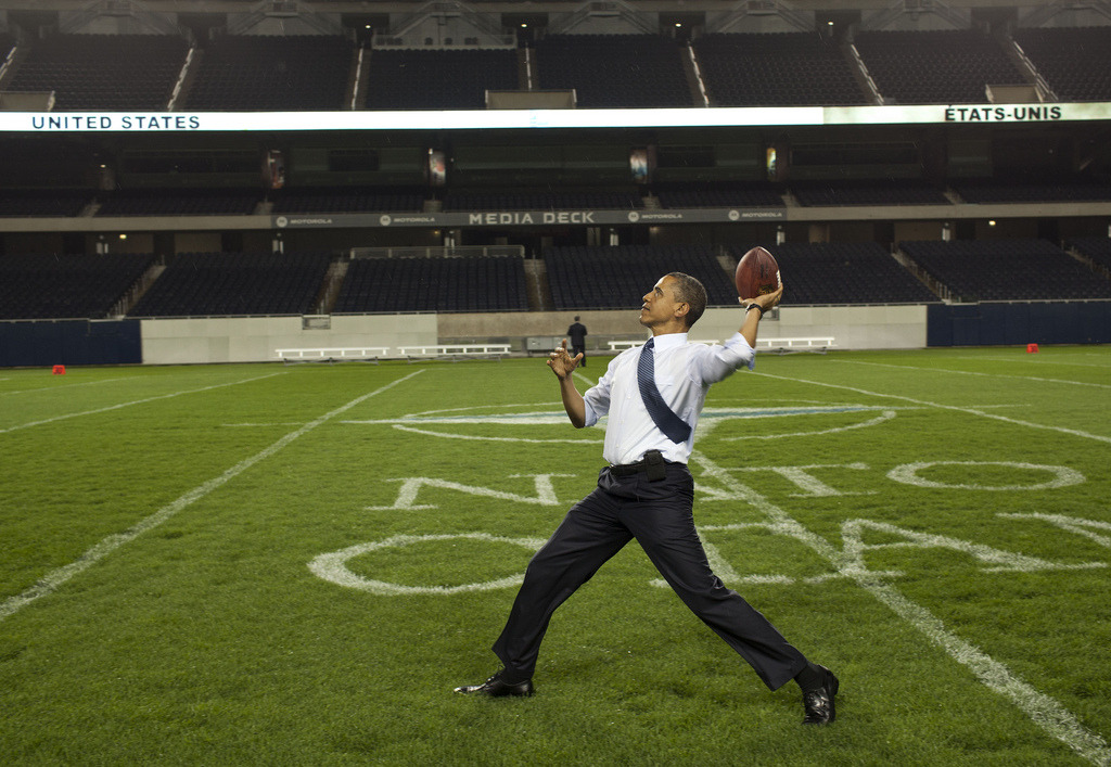 thedailyfeed:  Go long! President Obama stopped by Soldier Field after the NATO working dinner in Chicago, Illinois, yesterday.  Photo by White House photographer Pete Souza  Who's got the better arm, Obama or Jay Cutler?