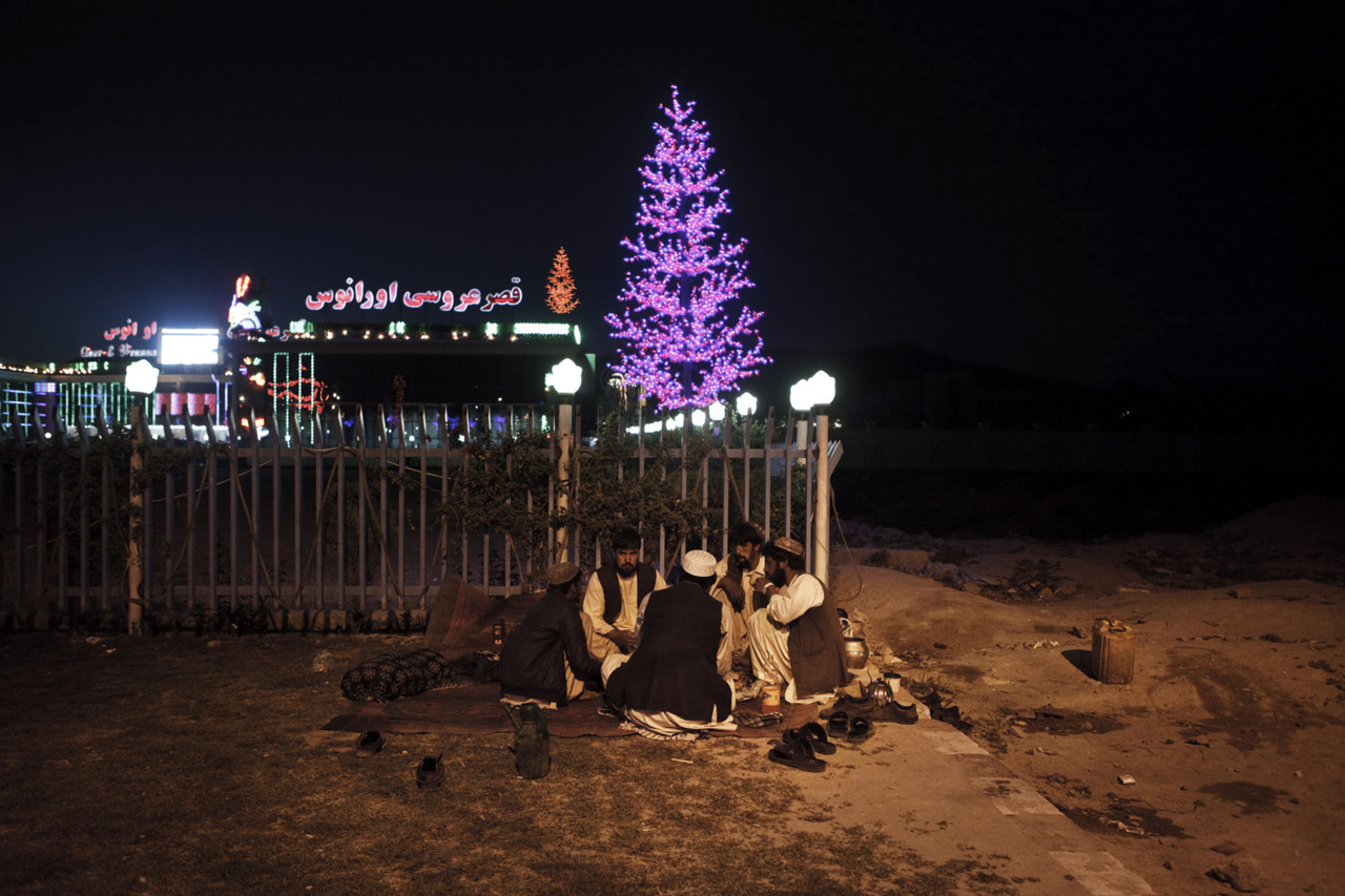 Picnicking outside a wedding hall. Photo: Sandra Calligaro The war in Afghanistan is not over. Help us tell the story. Fund our Kickstarter.
