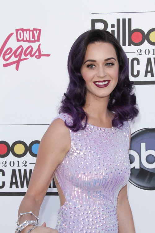 At the Grammy's were were baffled by her blue locks, and at the Billboard Awards we were puzzled by this purple hue. What do you guys think about Katy's rainbow of hair colors with accompanying dresses? Fabulous or not worthy of being Featured?