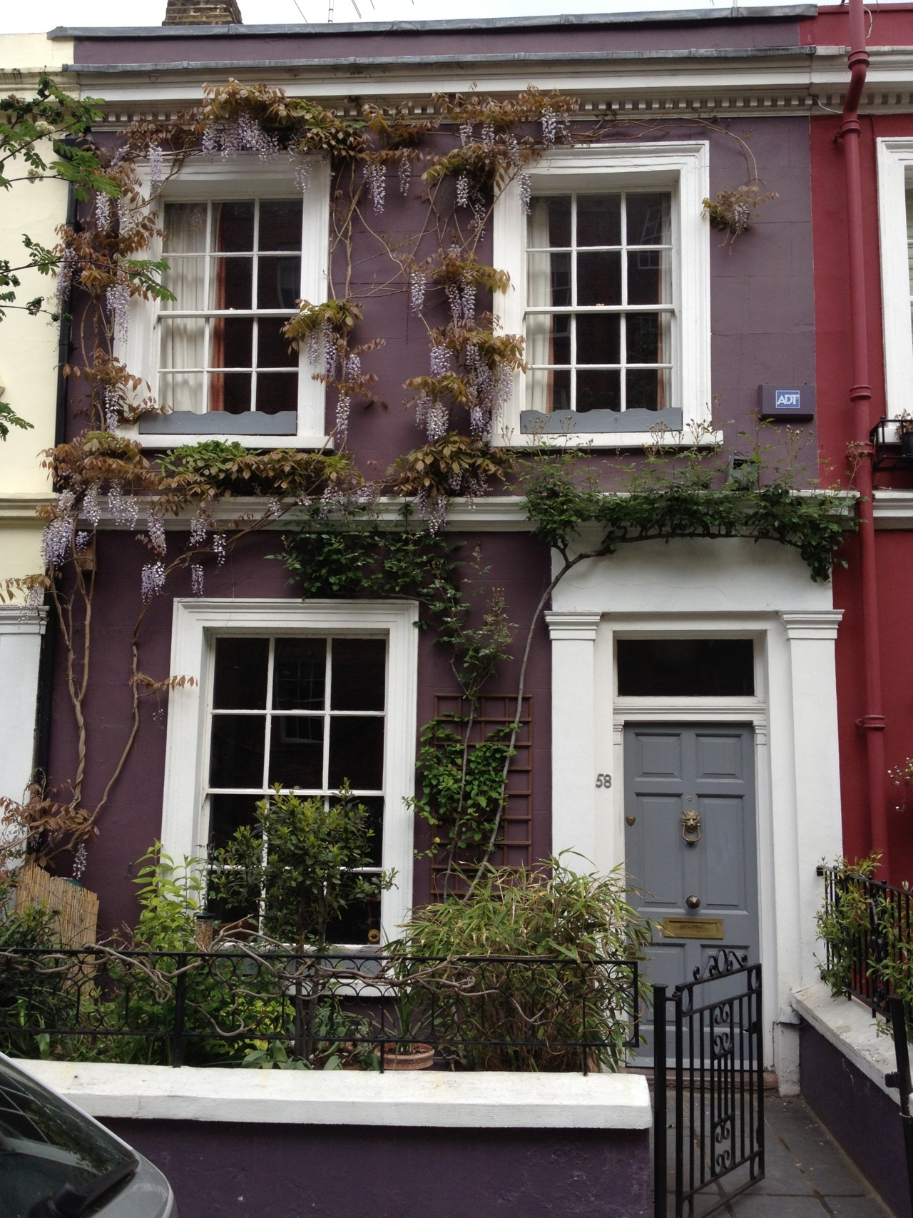 Saw this house in Portobello Road yesterday - there was something about it that struck me and I had to stop and admire the harmony going on here. Everything about this house feels at peace, the house looks so cosy. The warm purple and the flowers draping on the front, as well as the subtle grey of the front door and windows - all fit perfectly with the symmetrical design of the house. Basically I love this house-front, from colors to architecture! I can only imagine how beautiful it must be inside…