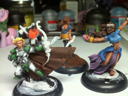 This pic of my three WIP miniatures looks strangely epic in posing - completely by accident!  Left - Talryn, an elven fighter/sorcerer Middle - Sidnei, a human swashbuckler Right - Sonaris, a Varisian human ritch/rogue (She's wearing a raccoon mask)