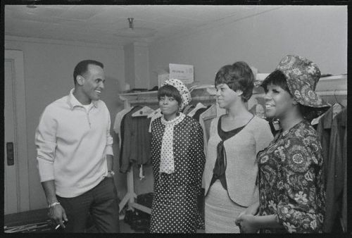 Harry Belafonte visiting The Supremes, Diana Ross, Florence Ballard and Mary Wilson, backstage at the Greek Theater in Los Angeles in August 1965. Photo: Bettman/Corbis