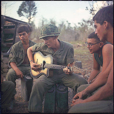 "collective-history:  OPERATION ""YELLOWSTONE"" VIETNAM: Following a hard day, a few members of Company ""A,"" 3rd Battalion, 22nd Infantry (Mechanized), 25th Infantry Division, gather around a guitar player and sing a few songs. (January 18, 1968)"
