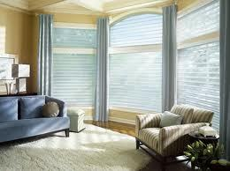Capturing a beautiful moment in this lovely home with its new blinds and draperies.