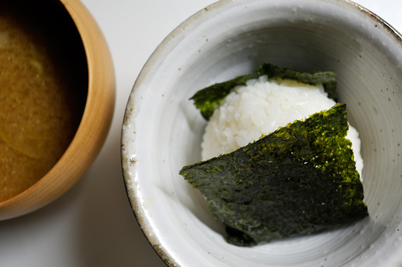 Onigiri  Onigiri or rice ball, is a Japanese food made from white rice formed into triangular or oval shapes and often wrapped in nori (seaweed).  (via saramdle:)
