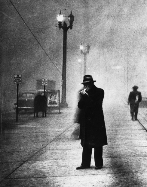 firsttimeuser:  Man Lights Cigarette in Daylight - Black Tuesday, 1939