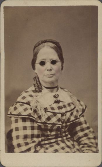 ca. 1870, [carte de visite portrait of a woman, presumably blind, with dark glasses], J. P. Blessing & Bro. via the Southern Methodist University Library, Lawrence T. Jones III Texas Photography Collection