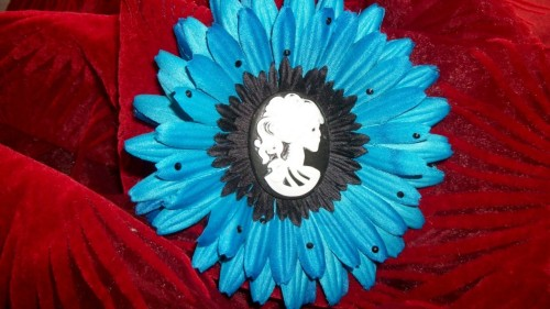A brilliant blue daisy, decorated with sapphire swarovski crystals, and a  Day of the Dead style cameo centre. $20