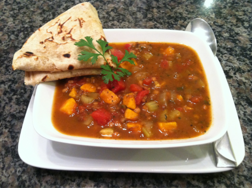 Vegan sweet potato & lentil Indian stew. Water sauté 1 chopped yellow onion, 1 chopped sweet potato, 1/2 cup chopped celery, and minced garlic to taste. Add 1 14.5-ounce can diced tomatoes, a 12-ounce package precooked lentils, 1 teaspoon minced fresh ginger, and 5 cups vegetable broth. Add 1-2 tablespoons garam masala, then cumin, cayenne, cilantro, salt, and pepper to taste. Bring to boil, lower heat, and simmer 10-15 minutes. Serve with rice or roti; serves 4.